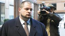 Constable James Forcillo briefly appeared before a disciplinary hearing at Toronto Police headquarters on a charge of discreditable conduct under the Police Services Act in the shooting of Sammy Yatim. (Chris Young/The Canadian Press)