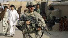A U.S. soldier from Stryker Brigade patrols in Kandahar city in this 2009 file photo (OMAR SOBHANI/REUTERS)