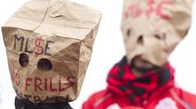 Toronto FC fans wear paper bags as a protest against the team's performance during their 1-0 defeat to D.C. United in MLS action in Toronto on Saturday, October 6, 2012. (The Canadian Press)