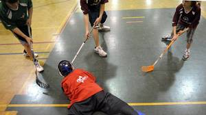 Junior students play in the Grassroots Floorball league at Crescent school in Toronto, May 7 , 2010.