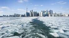 Passengers ride the Toronto Island Ferry on an ice covered Lake Ontario in Toronto on Jan. 9, 2014. (KEVIN VAN PAASSEN/THE GLOBE AND MAIL)