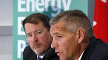 TransCanada CEO Russ Girling, right, and president of energy and oil pipelines Alex Pourbaix announce the company is moving forward with the Energy East pipeline project at a news conference in Calgary, Alta., on Aug. 1, 2013. (Jeff McIntosh/The Canadian Press)