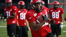 Calgary Stampeders' Nik Lewis catches a ball during the first day of training camp in Calgary, Alta., Sunday, June 3, 2012. (Jeff McIntosh/THE CANADIAN PRESS)