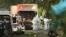 French police forces and forensic officers stand next to a truck July 15, 2016 that ran into a crowd celebrating the Bastille Day national holiday on the Promenade des Anglais killing at least 60 people in Nice, France, July 14. (Eric Gaillard/REUTERS)