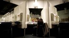 Richard Chenery rests after he injects heroin at Insite supervised facility in Vancouver in May, 2011. (John Lehmann/The Globe and Mail)