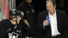 "The Pittsburgh Penguins' Sidney Crosby (L) chats with Penguins' General Manager Ray Shero during the ""morning skate"" in preparation for his return to action Monday night against the New York Islanders in Pittsburgh, Pennsylvania, November 21, 2011. REUTERS/David DeNoma (David DeNoma/Reuters)"