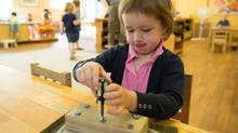 Grace practices her screwdriving skills at Dundas Valley Montessori School in Dundas, Ont. (Glenn Lowson For The Globe and Mail)