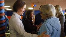 Alberta Premier and PC leader Alison Redford, left, greets an elderly supporter as she makes a campaign stop in Calgary, Alta., Saturday, March 31, 2012. (Jeff McIntosh/ The Canadian Press/Jeff McIntosh/ The Canadian Press)