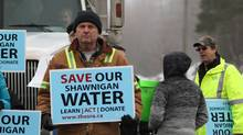 A truck is blocked from entering as citizens of Shawnigan Lake and Save Shawnigan Water Community Action Group supporters protest non-compliance at the South Island Aggregates site to protect their sensitive watershed area from SIA dumping contaminated soil at Shawingan Lake, B.C., January 6, 2016. (CHAD HIPOLITO For The Globe and Mail)