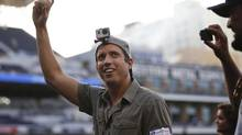 GoPro founder and CEO Nick Woodman wears a GoPro camera on his head before throwing out a ceremonial first pitch before a baseball game (GREGORY BULL/AP)