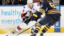 Ottawa Senators centre Jason Spezza tries to keep the puck away from Buffalo Sabres centre Jochen Hecht in game on New Year's Eve 2011. (Timothy T. Ludwig/US PRESSWIRE/Timothy T. Ludwig/US PRESSWIRE)