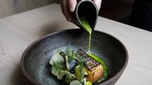 Dishes such as salmon with charred cucumber comprise the brief but thoughtful menu at Alta. (CODIE MCLACHLAN)