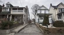 A realtor's sign is placed on the front yard of a home for sale at 138 Barton Ave. in Toronto on March 20 2017. (Fred Lum/The Globe and Mail)