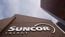 The Suncor Energy sign is seen outside Suncor's head office in Calgary, Alberta, October 2, 2009. (© Todd Korol / Reuters)