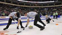 Lead Ryan Harnden (L) and second E.J. Harnden sweep for skip Brad Jacobs against Team John Morris during the men's final at the Roar of the Rings Canadian Olympic Curling Trials in Winnipeg December 8, 2013. (FRED GREENSLADE/REUTERS)