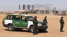 Algerian soldiers stand near the Tiguentourine Gas Plant in In Amenas, 1,600 km (994 miles) southeast of Algiers, Jan. 31, 2013. (LOUAFI LARBI/REUTERS)