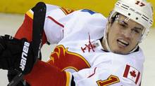 In this Jan. 3, 2012, photo, Calgary Flames left wing Rene Bourque works for the puck during an NHL hockey game against the Washington Capitals in Washington. The Montreal Canadiens have traded forward Michael Cammalleri to the Flames for Bourque. Canadiens general manager Pierre Gauthier confirmed the deal Thursday night, Jan. 12, 2012. (AP Photo/Nick Wass) (Nick Wass/AP)