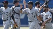 Chicago White Sox, from left to right, Alexei Ramirez, Tyler Flowers, Jose Abreu, Zach Putnam, and Leury Garcia celebrate the White Sox's 4-3 victory over the Toronto Blue Jays during MLB baseball action in Toronto on Saturday, June 28, 2014. (Darren Calabrese/THE CANADIAN PRESS)