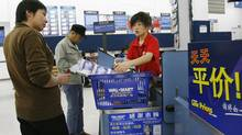 Wal-Mart has grown to about 350 stores and well over 100,000 'associates' in China since opening on the mainland 15 years ago. (CLARO CORTES IV/CLARO CORTES IV/REUTERS)