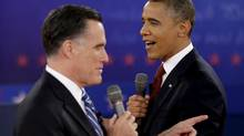 In this Oct. 18, 2012 file photo, U.S. President Barack Obama, right, and Republican presidential candidate Mitt Romney exchange views during the second presidential debate at Hofstra University in Hempstead, N.Y. (David Goldman/Associated Press)