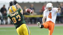 Edmonton Eskimos' Justin Cooper, left, attempts to block the kick from BC Lions' Paul McCallum, during the second half CFL action in Edmonton on Sunday, July 4, 2010. THE CANADIAN PRESS/John Ulan (John Ulan/ The Canadian Press/John Ulan/ The Canadian Press)