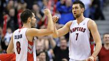 Toronto Raptors Andrea Bargnani is congratulated by teammate Jose Calderon after scoring against the Los Angeles Clippers in Toronto, Feb. 13, 2011. (Mark Blinch/Reuters/Mark Blinch/Reuters)
