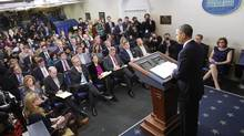 Reporters listen to U.S. President Barack Obama speak about the sequester after he met with congressional leaders at the White House in Washington March 1. (KEVIN LAMARQUE/REUTERS)