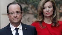 In this photo from May, 2013, French President François Hollande and his now-former companion Valerie Trierweiler arrive for a state dinner at the Elysee Palace in Paris. (Thibault Camus/Associated Press)