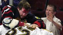 In this Oct. 28, 2001 file photo, Chicago Blackhawks' Bob Probert, left, and Boston Bruins' Andrei Nazarov mix it up along the boards during a first period fight in Chicago. (AP Photo/Fred Jewell, File) (Fred Jewell/AP)
