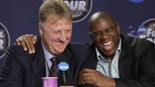 "In this April 6, 2009 file photo, former NBA players Earvin ""Magic"" Johnson, right, and Larry Bird laugh at a news conference before the championship game between Michigan State and North Carolina at the men's NCAA Final Four college basketball tournament in Detroit. Johnson continues his zest for life 20 years after being diagnosed with HIV. (AP Photo/Paul Sancya) (Paul Sancya/AP)"