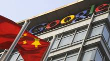 A Chinese flag flies over the company logo outside the Google China headquarters in Beijing on January 14, 2010. (LIU JIN/AFP/Getty Images)
