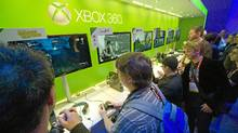 Attendees play with Microsoft Corp.'s Xbox 360 game console during the Consumer Electronics Show in Las Vegas, on Wednesday, Jan. 11, 2012. (David Paul Morris/Bloomberg)