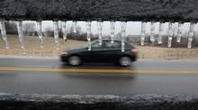 Image of a car driving in winter. (Matt Kryger/AP)