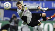 Borussia Dortmund's goalkeeper Mitchell Langerak makes a save during their German Bundesliga first division soccer match against Hamburger SV in Hamburg on Sunday. (FABIAN BIMMER)