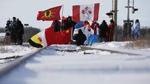 Idle No More demonstrators block a CN east-west track just west of Portage La Prairie, Manitoba Wednesday, January 16, 2016. (JOHN WOODS/THE CANADIAN PRESS)