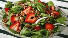 Adding strawberries to a spinach salad is a good plan, as vitamin C helps the body to absorb iron. (adlifemarketing/Getty Images/iStockphoto)