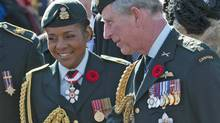 Governor-General Michaelle Jean and Prince Charles speak with veterans after a Remembrance Day ceremony in Ottawa on Wednesday, November 11, 2009. (Adrian Wyld)