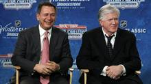 Detroit Red Wings general manager Ken Holland, left, and Toronto Maple Leafs president and general manager Brian Burke speak at a news conference to announce the NHL Winter Classic hockey game at Comerica Park in Detroit. (Paul Sancya/Associated Press)