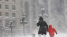 A woman walks with her child in past Notre-Dame Basilica in Old Montreal on Thursday Dec. 27, 2012. (Alexander Panetta/THE CANADIAN PRESS)