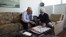 Sandra Atlin plays Scrabble with her husband Gordon, who has Alzheimer's disease, at their home in Toronto on Friday, Oct. 11, 2013. More and more Canadians are being thrust into a job they never expected to assume and rarely have training for - as primary caregiver for a loved one with dementia. THE CANADIAN PRESS/Nathan Denette (Nathan Denette/THE CANADIAN PRESS)