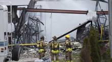Firefighters watches an industrial fire in Mississauga, ON on Wednesday, April 23, 2014. (THE CANADIAN PRESS/Darren Calabrese)