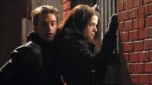 "Scott Speedman and Emily Hampshire in a scene from ""Good Neighbours"""