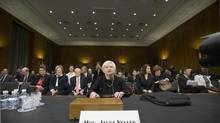 Janet Yellen defends the Fed's stimulus policies as she testifies at her confirmation hearing before the Senate banking committee. (J. SCOTT APPLEWHITE/AP)