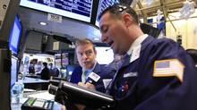 Traders work on the floor of the New York Stock Exchange January 4, 2012. (REUTERS/Brendan McDermid/REUTERS/Brendan McDermid)