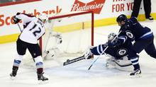 Winnipeg Jets goalie Ondrej Pavelec (31) makes a diving save during the second period against the Colorado Avalanche at MTS Centre in Winnipeg on Saturday, March 12, 2016. (Bruce Fedyck/USA Today Sports)
