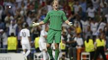 Manchester City's goalkeeper Joe Hart reacts after Real Madrid's Cristiano Ronaldo (not pictured) scored his team's third goal during their Champions League Group D match at the Santiago Bernabeu stadium in Madrid, September 18, 2012. (SUSANA VERA/REUTERS)