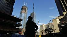 A New York City police officer stands watch outside the World Trade Center construction site on Sept. 9, 2011. (BRIAN SNYDER/REUTERS)