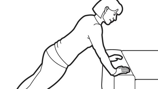 Face the sofa. Place your hands on the edge of the sofa and your feet on the floor. Keep your elbows and arms straight – your body should form a straight line from your feet to your shoulders. Maintain this plank position and pull your shoulder blades together. TIP: Don't arch or round your back. Imagine you are trying to crack a walnut with your shoulder blades. If you can't help but arch or round your lower back, modify the exercise by placing your knees on the ground. (Trish McAlaster)