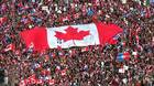 In this Friday, Oct. 27, 1995 file picture, a large Canadian flag is passed through a crowd in as thousands streamed into Montreal from all over Canada to join Quebecers rallying for national unity three days before a referendum that could propel Quebec toward secession.