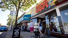Pedestrians pause to look in the Pirate Joe's store in Vancouver, on August 21, 2013. . A Washington state judge has dismissed a lawsuit filed by U.S. grocery giant Trader Joe's against the B.C. retailer. (DARRYL DYCK/THE CANADIAN PRESS)